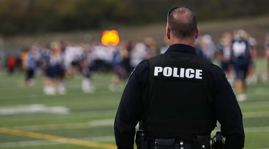 Re-evaluating the Cost and Consequences of Cops in Schools
